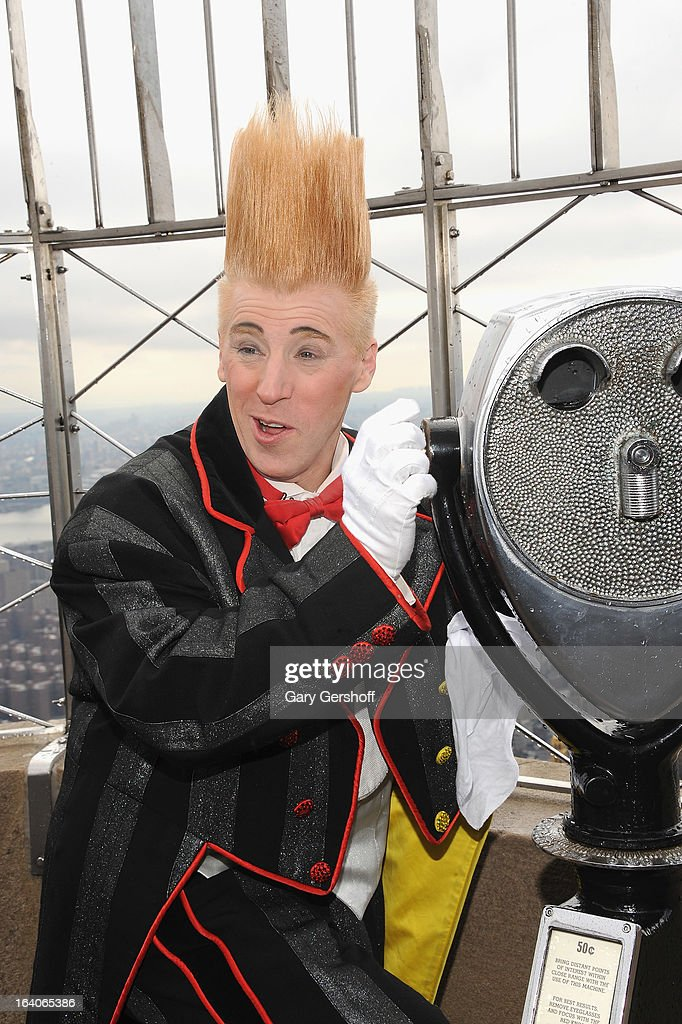 Comic daredevil <a gi-track='captionPersonalityLinkClicked' href=/galleries/search?phrase=Bello+Nock&family=editorial&specificpeople=2526765 ng-click='$event.stopPropagation()'>Bello Nock</a> visits the Observation Deck of The Empire State Building on March 19, 2013 in New York City.