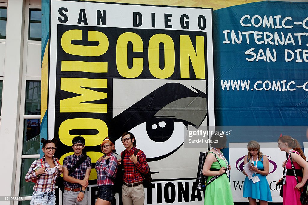 Comic fans stand outside of the Convention Center during Comic Con on July 19, 2013 in San Diego, California. The Comic Con International Convention is the world's largest comic and entertainment event and hosts celebrity movie panels, a trade floor with comic book, science fiction and action film-related booths, as well as artist workshops and movie premieres.