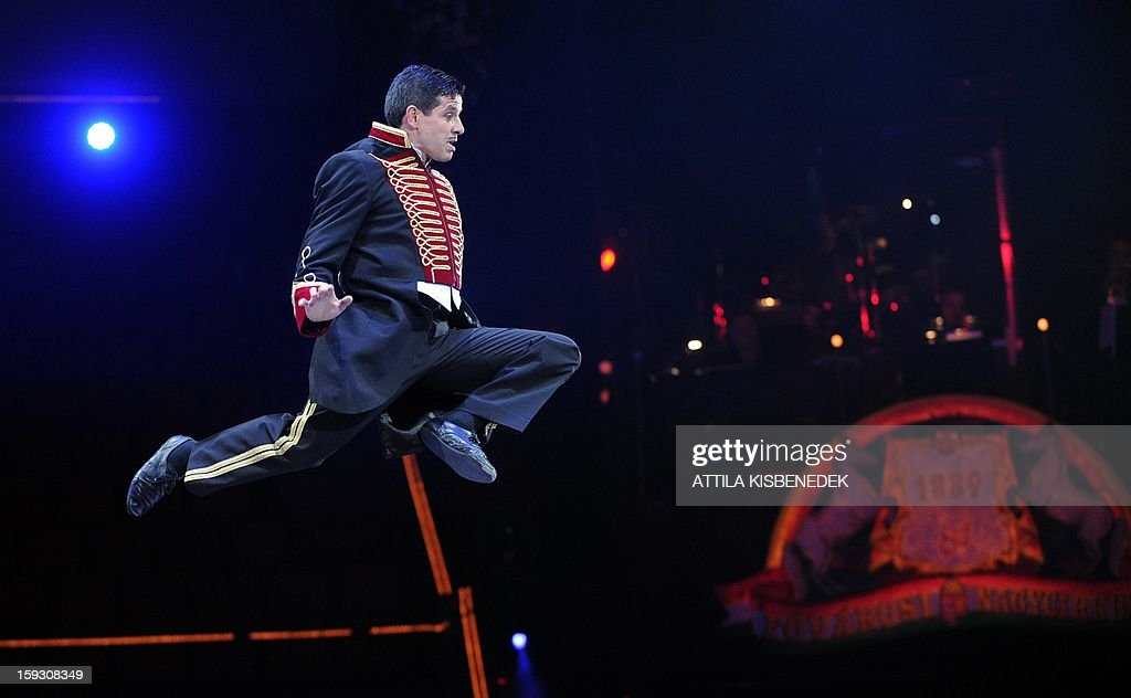 A comic-acrobat performs a jump in the air in the Grand Circus of Budapest on January 11, 2013 during a rehearsal of the of a new production, title the 'Hungarian circus stars'. The premiere will be held on January 12.