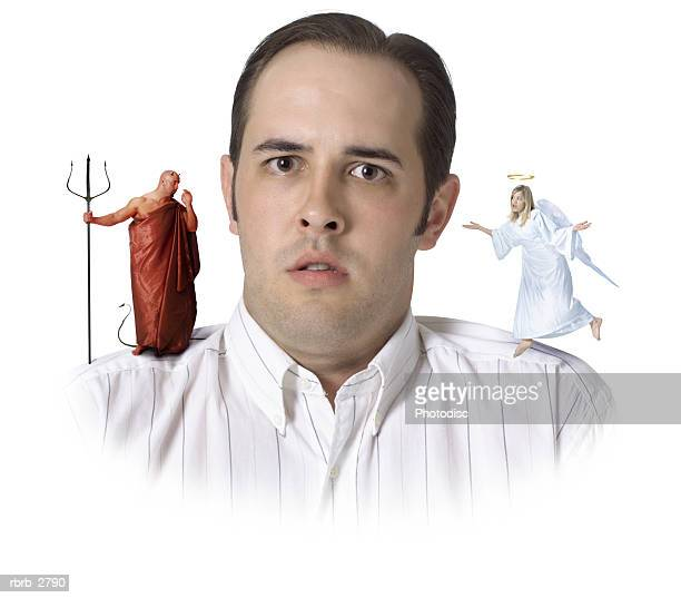 comical conceptual shot of a male getting advice from both an angel and a devil