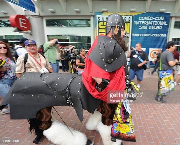 ComicCon attendee Karl Zingheim walks through the entrance of the San Diego Convention Center for ComicCon 2011 on July 21 2011 in San Diego...