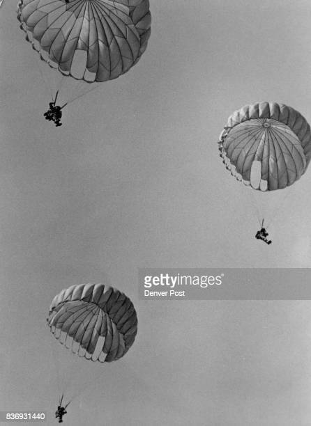 Coming down for the 507th Three parachutists float toward earth at Buckley Air National Guard Base after jumping from a helicopter in honor of...