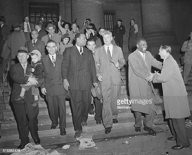 Coming down the steps of Federal Court Nov 3 after they were released on $260000 bail are the convicted leaders of the US Communist Party The 11...