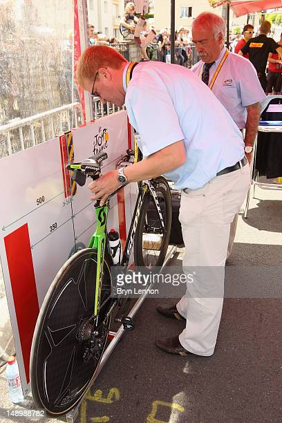 Comissaire inspects the bike of a member of the Orica Greenedge rider ahead of stage nineteen of the 2012 Tour de France a 535km time trial from...