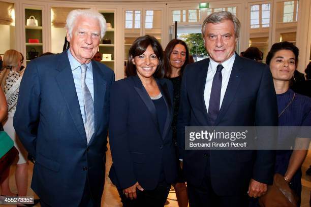 CEO Comite Montaigne Jean Claude Cathalan Mayor of Paris Anne Hidalgo and CEO Dior Sidney Toledano attend the 'Promenade pour un objet d'exception'...