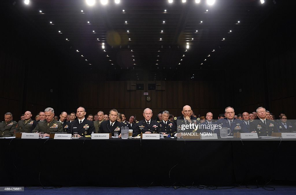 Commandant of the Marine Corps Gen. James Amos, Chief of Naval Operations Adm. Jonathan Greenert, Vice Chairman of the Joint Chiefs of Staff Adm. James Winnefeld, Chairman of the Joint Chiefs of Staff Gen. Martin Dempsey, Chief of Staff of the Army Gen. Raymond Odierno, Chief of Staff of the Air Force Gen. Mark Welsh, and Chief of the National Guard Bureau Gen. Frank Grass appear before the Senate Armed Services Committee to testify on Defense Department proposals relating to military compensation in the Hart Senate Office Building on Capitol Hill on May 6, 2014 in Washington, DC. AFP PHOTO/Mandel NGAN