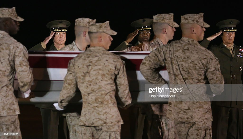 Commandant of the Marine Corps Gen. James Amos, Deputy Commandant Lt. Gen. Ronald Bailey and Deputy Commandant Lt. Gen. William Faulkner salute as a U.S. Marine Corps carry team transfers the remains of Staff Sgt. David Stewart at Dover Air Force Base June 23, 2014 in Dover, Delaware. Members of the 2nd Combat Engineer Battalion, 2nd Marine Division, II Marine Expeditionary Force at Camp Lejeune, Stewart, Lance Cpl. Brandon Garabrant of Peterborough, New Hampshire; and Lance Cpl. Adam Wolff of Cedar Rapids, Iowa, were killed Friday when their vehicle was struck by a roadside bomb in Helmand province in southern Afghanistan.
