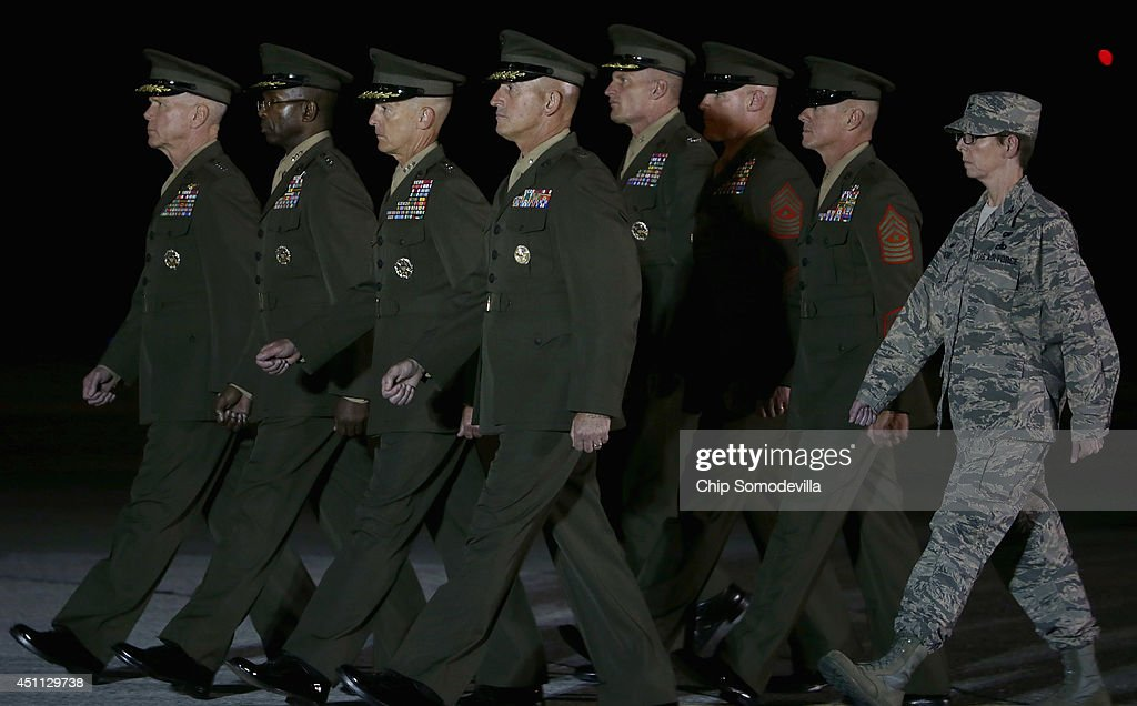 Commandant of the Marine Corps Gen. James Amos, Deputy Commandant Lt. Gen. Ronald Bailey, Deputy Commandant Lt. Gen. William Faulkner, Brig. Gen. James Lukeman; Sgt. Maj. Michael Barrett; Sgt. Jaj. Bryan Zickefoose and Air Force Col. Gretchen Wiltse arrive for the dignified transfer of three Marines at Dover Air Force Base June 23, 2014 in Dover, Delaware. Members of the 2nd Combat Engineer Battalion, 2nd Marine Division, II Marine Expeditionary Force at Camp Lejeune, Staff Sgt. David Stewart of Stafford, Virginia; Lance Cpl. Brandon Garabrant of Peterborough, NH; and Lance Cpl. Adam Wolff of Cedar Rapids, Iowa were killed Friday when their vehicle was struck by a roadside bomb in Helmand province in southern Afghanistan.
