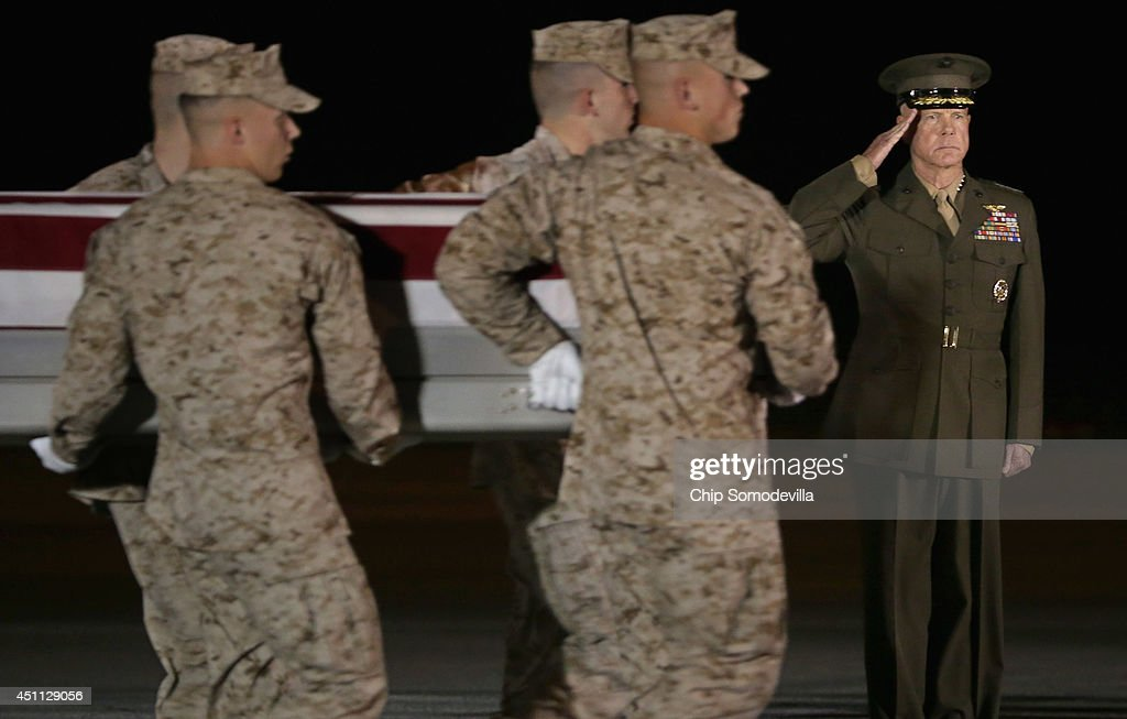 Commandant of the Marine Corps Gen. James Amos (R) salutes as a U.S. Marine Corps carry team transfers the remains of Staff Sgt. David Stewart at Dover Air Force Base June 23, 2014 in Dover, Delaware. Members of the 2nd Combat Engineer Battalion, 2nd Marine Division, II Marine Expeditionary Force at Camp Lejeune, Stewart, Lance Cpl. Brandon Garabrant of Peterborough, New Hampshire; and Lance Cpl. Adam Wolff of Cedar Rapids, Iowa, were killed Friday when their vehicle was struck by a roadside bomb in Helmand province in southern Afghanistan.