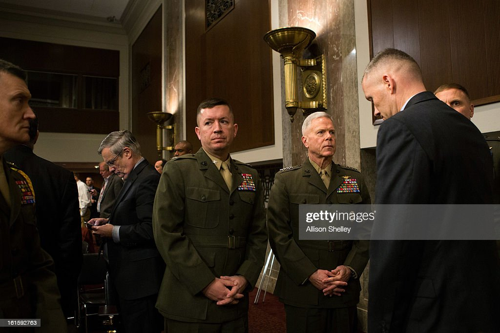 Commandant of the Marine Corps Gen. James Amos, third from right, confers with his staff while waiting for testimony to resume during a hearing in which defense department officials are testifying before the Senate Armed Services Committee on the impacts of sequestration and/or a full-year continuing resolution on Capitol Hill February 12, 2013 in Washington, DC. In order to pay down the deficit the cuts are designed to force savings of $1.2 trillion through 2021.