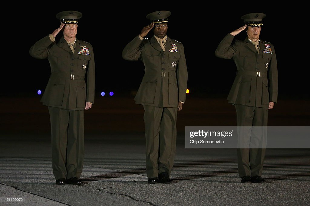 Commandant of the U.S. Marine Corps Gen. James Amos, Deputy Commandant Lt. Gen. Ronald Bailey and Deputy Commandant Lt. Gen. <a gi-track='captionPersonalityLinkClicked' href=/galleries/search?phrase=William+Faulkner&family=editorial&specificpeople=214195 ng-click='$event.stopPropagation()'>William Faulkner</a> salute during the dignified transfer of three Marines at Dover Air Force Base June 23, 2014 in Dover, Delaware. Members of the 2nd Combat Engineer Battalion, 2nd Marine Division, II Marine Expeditionary Force at Camp Lejeune, Staff Sgt. David Stewart of Stafford, Virginia; Lance Cpl. Brandon Garabrant of Peterborough, New Hampshire; and Lance Cpl. Adam Wolff of Cedar Rapids, Iowa were killed Friday when their vehicle was struck by a roadside bomb in Helmand province in southern Afghanistan.