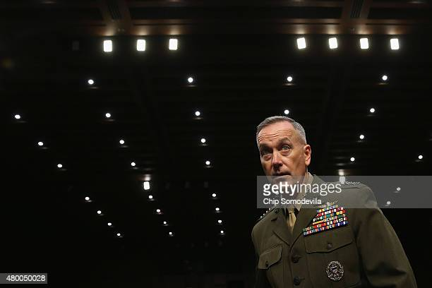 Commandant of the US Marine Corps General Joseph Dunford Jr arrives for his confirmation hearing before the Senate Armed Services Committee to be the...