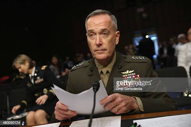 Commandant of the US Marine Corps General Joseph Dunford Jr prepares to testify before the Senate Armed Services Committee during his confirmation...