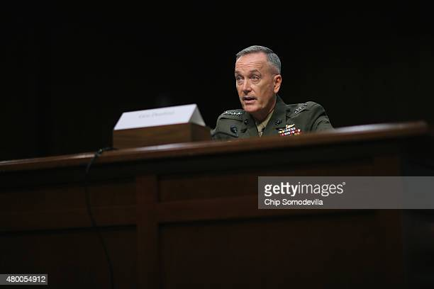 Commandant of the US Marine Corps General Joseph Dunford Jr testifies before the Senate Armed Services Committee during his confirmation hearing to...