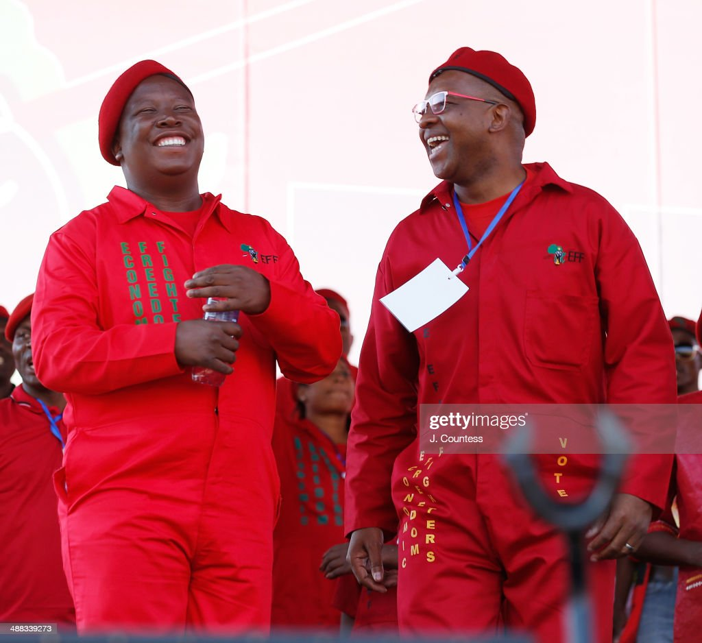 Commander and chief of the Economic Freedom Fighters and South African presidential candidate <a gi-track='captionPersonalityLinkClicked' href=/galleries/search?phrase=Julius+Malema&family=editorial&specificpeople=5866727 ng-click='$event.stopPropagation()'>Julius Malema</a> and Peoples Advocate Dali Mpofu attend an Economic Freedom Fighters presidential campaign rally at the Lucas Moripe Stadium on May 4, 2014 in Pretoria, South Africa. The rally comes prior to the South African presidential elections which are scheduled to be held on May 7, 2014.
