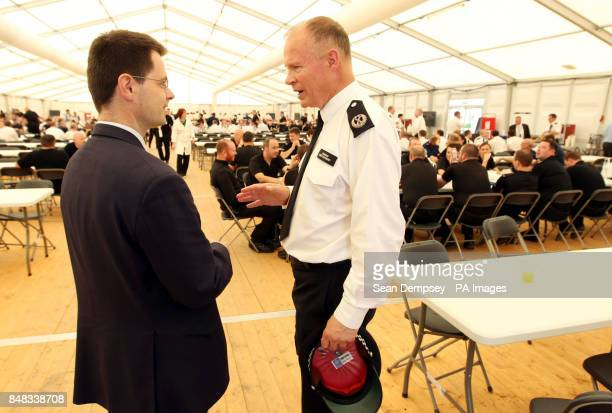 Commander Bob Broadhurst with Security Minister Police James Brokenshire at Battersea Power Station in south London where police officers are briefed...