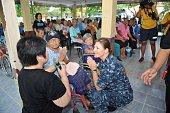 Commander Carol McKenzie commanding officer of the amphibious dock landing ship USS Germantown LSD 42 speaks with Lamai Auiyabuth at Banglamung Home...