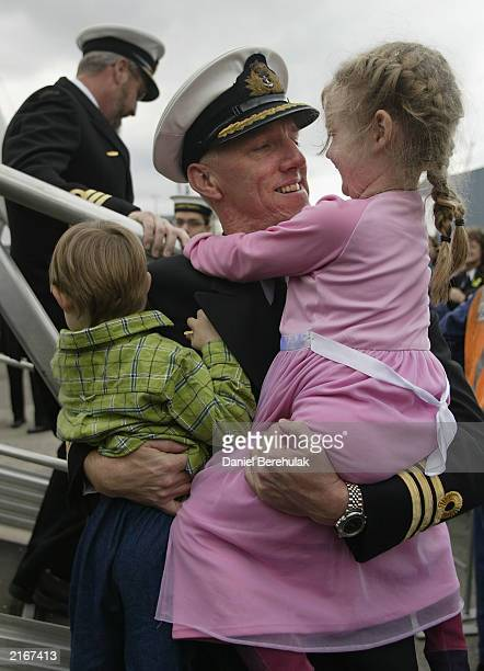 Commander David McCourt is reunited with his family