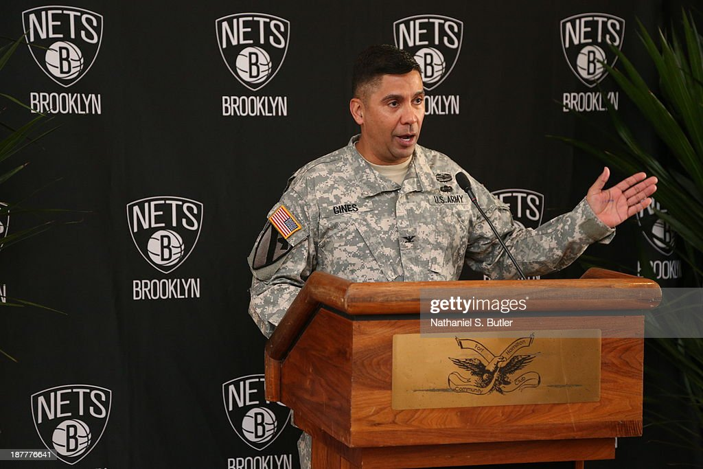 Commander, Eluyn Gines speaks during a Brooklyn Nets team event in celebration of Veterans Day at Ft. Hamilton, Brooklyn on November 11, 2013 in the Brooklyn borough of New York City.