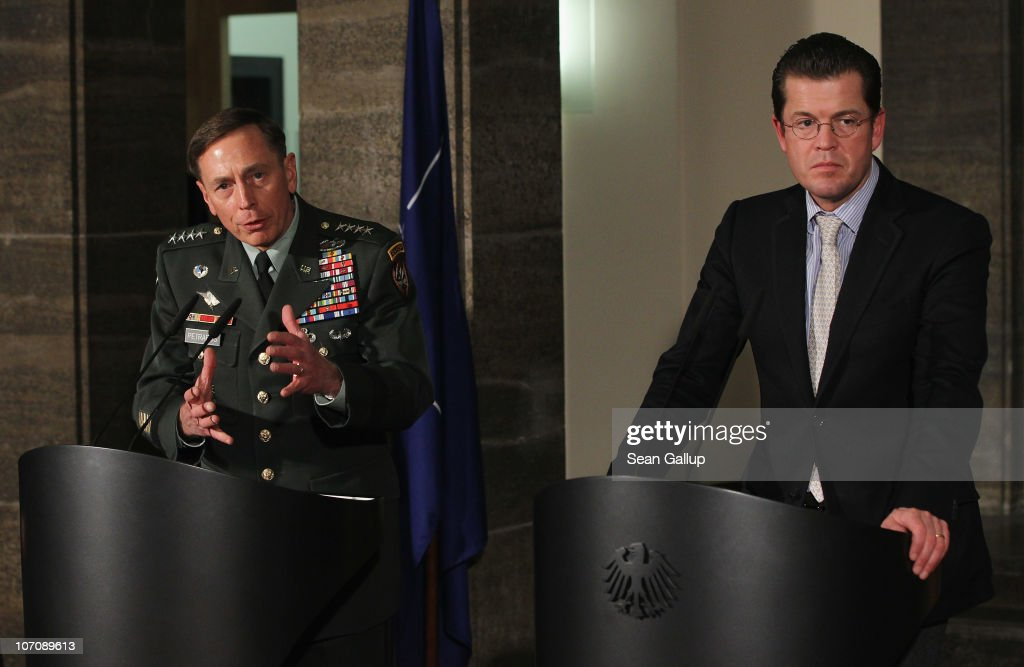 Commander General <a gi-track='captionPersonalityLinkClicked' href=/galleries/search?phrase=David+Petraeus&family=editorial&specificpeople=175826 ng-click='$event.stopPropagation()'>David Petraeus</a> (L) and German Defense Minister <a gi-track='captionPersonalityLinkClicked' href=/galleries/search?phrase=Karl-Theodor+zu+Guttenberg&family=editorial&specificpeople=5585450 ng-click='$event.stopPropagation()'>Karl-Theodor zu Guttenberg</a> speak to the media after talks on November 23, 2010 in Berlin, Germany. Petraeus is in Berlin to discuss the current situation in Afghanistan and the recently-announced decision by NATO to pull its troops out by 2014. Germany has approximately 4,500 Bundeswehr soldiers serving in Afghanistan.