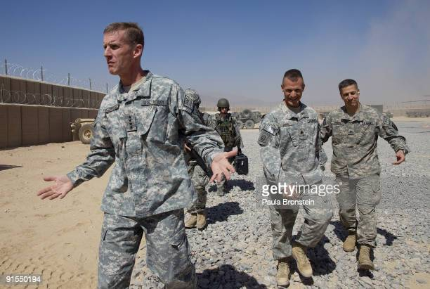 Commander General Stanley A McChrystal arrives from a helicopter with his staff at a small military outpost for a meeting with high ranking military...