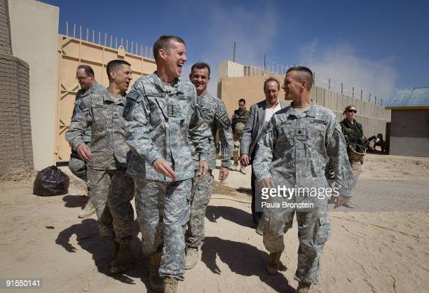 Commander General Stanley A McChrystal jokes with his staff walking along side Lt Colonel Frank Jenio after arriving from a helicopter for a meeting...
