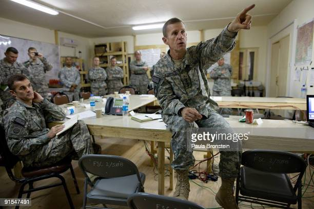 Commander General Stanley A McChrystal points to a diagram on the board as he meets with high ranking military personnel October 7 2009 at the...