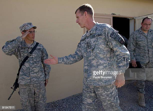 Commander General Stanley A McChrystal shakes a soldier's hand as he salutes after a meeting with high ranking military personnel October 7 2009 at...