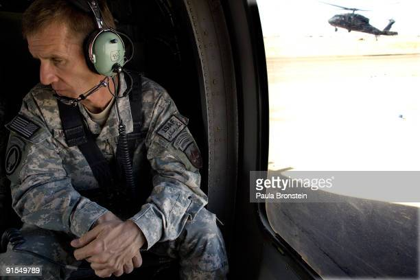 Commander General Stanley A McChrystal sits in the helicopter after a lengthy conference meeting with military officials October 7 2009 at the...