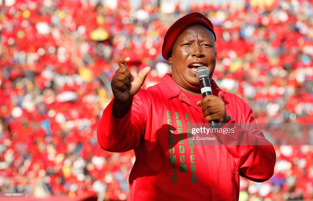 Commander in Chief of the Economic Freedom Fighters and South African presidential candidate <a gi-track='captionPersonalityLinkClicked' href=/galleries/search?phrase=Julius+Malema&family=editorial&specificpeople=5866727 ng-click='$event.stopPropagation()'>Julius Malema</a> addresses supporters at an Economic Freedom Fighters presidential campaign rally at the Lucas Moripe Stadium on May 4, 2014 in Pretoria, South Africa. The rally comes prior to the South African Presidential elections which are scheduled to be held on May 7, 2014.