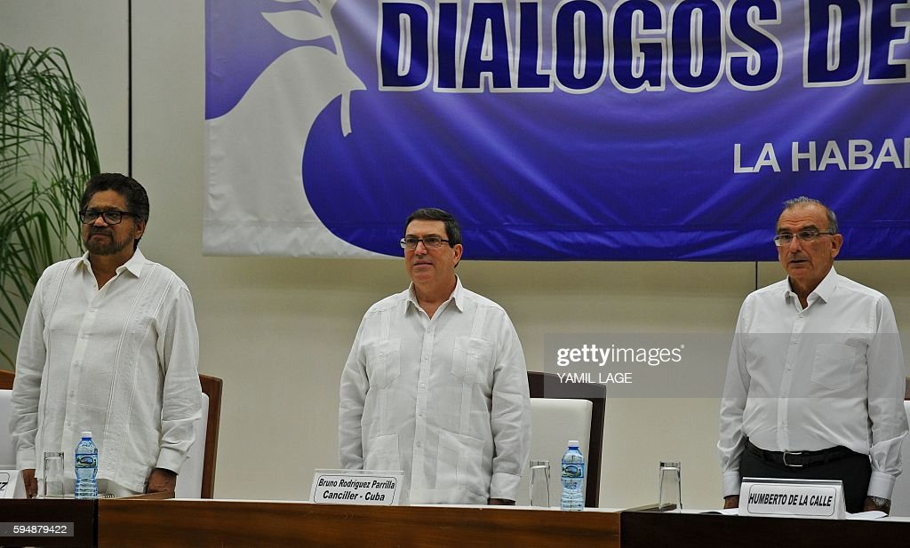 FARCEP Commander Ivan Marquez Cuban Foreign Minister Bruno Rodriguez and the head of the Colombian government delegation Humberto de la Calle attend...