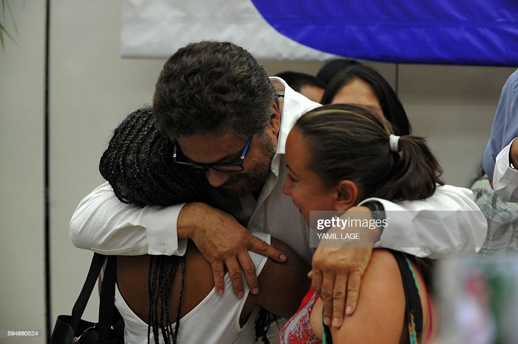 Commander Ivan Marquez embraces victims of the Colombian armed conflict after the signing of the agreement with the Colombian government at the...