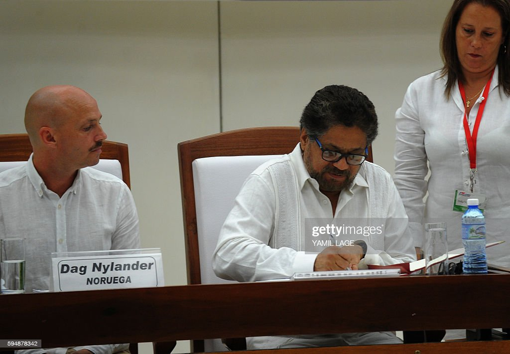 Commander Ivan Marquez signs the agreement of the conclusion of the peace talks in Havana at the Convention Palace in Havana on August 24 2016 At...