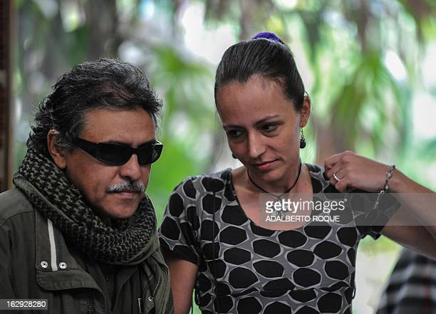 Commander Jesus Santrich and Dutch guerrilla fighter Tanja Nijmeijer members of FARCEP leftist guerrillas delegation arrive at the Convention Palace...