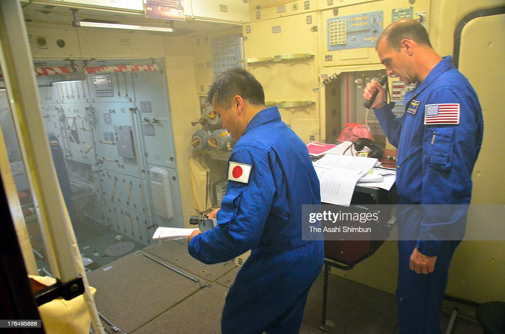 Commander <a gi-track='captionPersonalityLinkClicked' href=/galleries/search?phrase=Koichi+Wakata&family=editorial&specificpeople=220363 ng-click='$event.stopPropagation()'>Koichi Wakata</a> of Japan (L) and Flight Engineer Richard Mastracchio of USA attend the fire exercise at Yuri Gagarin Cosmonaut Training Center on August 12, 2013 in Moscow, Russia. Wakata is appointed as the commander of Expedition 39 of the International Space Station (ISS), that will launch in November.