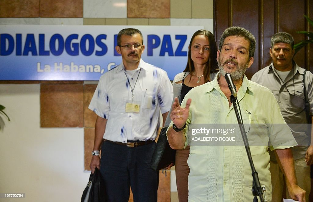 Commander Marcos Calarca, member of the Revolutionary Armed Forces of Colombia (FARC) leftist guerrilla delegation, gives a statement before the start of a peace talks' session with the Colombian Government at the Conventions Palace in Havana, on April 29, 2013. Colombian peace talks designed to end Latin America's last and oldest insurgency resumed on April 23 after a month's recess. Since the negotiations began on November 19, only the first item on the agenda -- land reform -- has been addressed although the rebels have suggested some 100 other measures. AFP PHOTO/ADALBERTO ROQUE