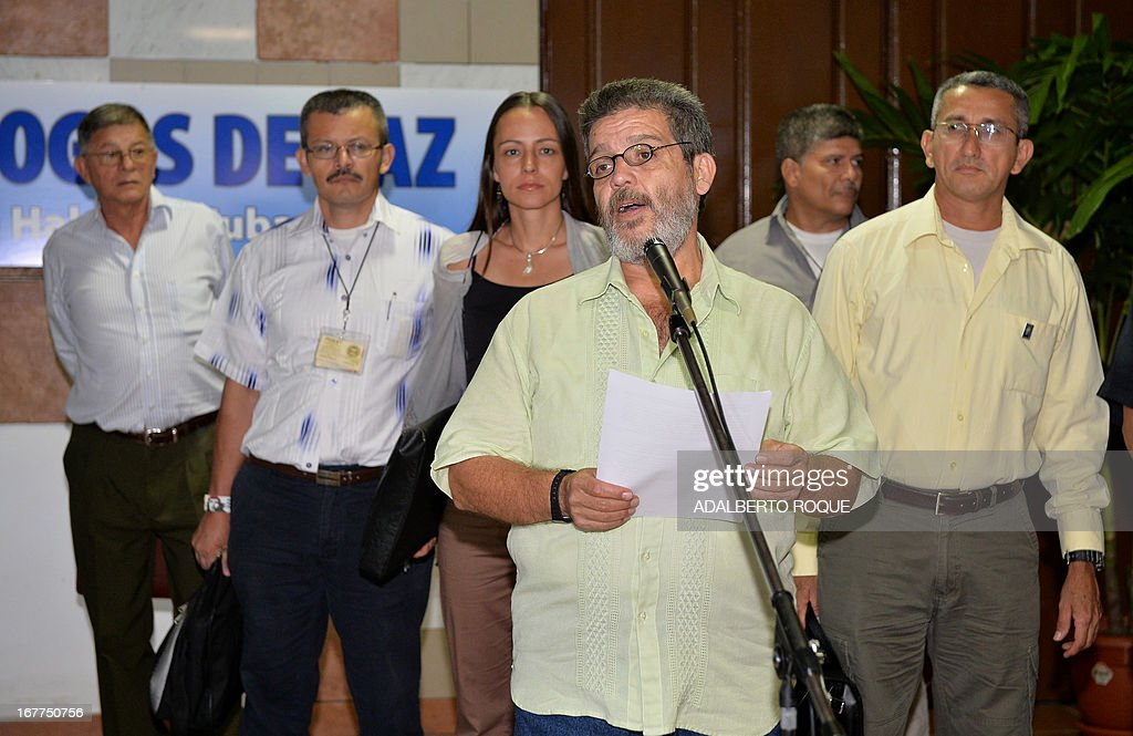 Commander Marcos Calarca, member of the Revolutionary Armed Forces of Colombia (FARC) leftist guerrilla delegation, reads a statement before the start of a peace talks' session with the Colombian Government at the Conventions Palace in Havana, on April 29, 2013. Colombian peace talks designed to end Latin America's last and oldest insurgency resumed on April 23 after a month's recess. Since the negotiations began on November 19, only the first item on the agenda -- land reform -- has been addressed although the rebels have suggested some 100 other measures. AFP PHOTO/ADALBERTO ROQUE