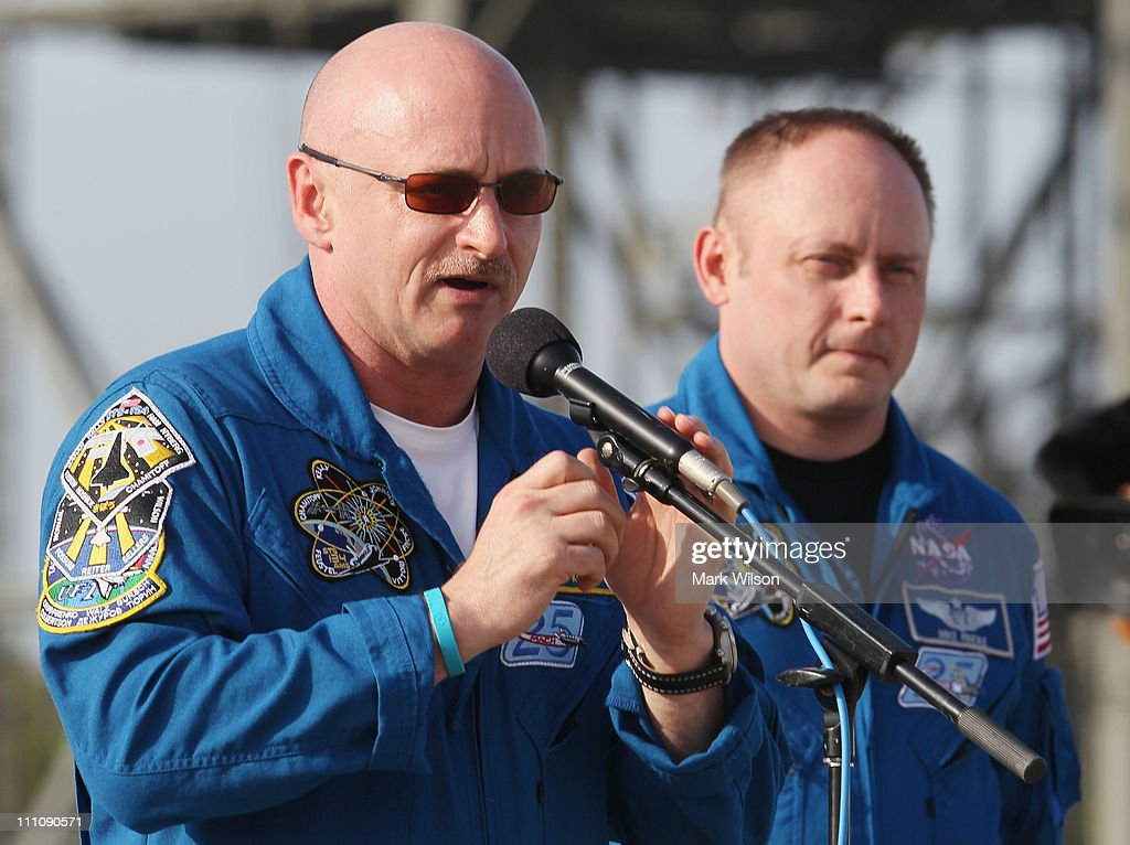 Commander <a gi-track='captionPersonalityLinkClicked' href=/galleries/search?phrase=Mark+Kelly+-+Astronaut+and+Gun+Control+Advocate&family=editorial&specificpeople=566699 ng-click='$event.stopPropagation()'>Mark Kelly</a> (L), speaks to the media while flanked by Mission Specialists Michael Fincke (R) after arriving at the shuttle landing facility for the Terminal Countdown Demonstration Test at Kennedy Space Spacecraft Center, on March 29, 2011 in Cape Canaveral, Florida. The TCDT will culminate in a full dress rehearsal for the planned April 19th launch of Space Shuttle Endeavour's final scheduled flight to the International Space Station before being retired.