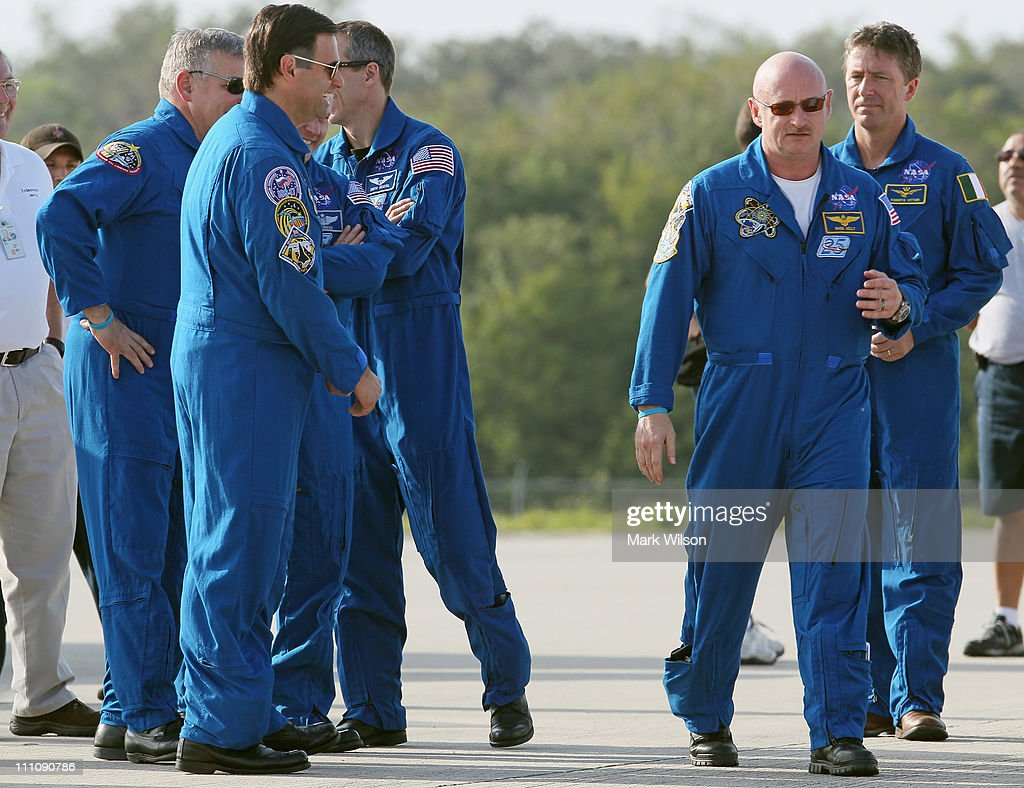 Commander <a gi-track='captionPersonalityLinkClicked' href=/galleries/search?phrase=Mark+Kelly+-+Astronaut+and+Gun+Control+Advocate&family=editorial&specificpeople=566699 ng-click='$event.stopPropagation()'>Mark Kelly</a> (2nd-R) walks up to speak to the media after arriving at the shuttle landing facility for the Terminal Countdown Demonstration Test at Kennedy Space Spacecraft Center, on March 29, 2011 in Cape Canaveral, Florida. The TCDT will culminate in a full dress rehearsal for the planned April 19th launch of Space Shuttle Endeavour's final scheduled flight to the International Space Station before being retired.