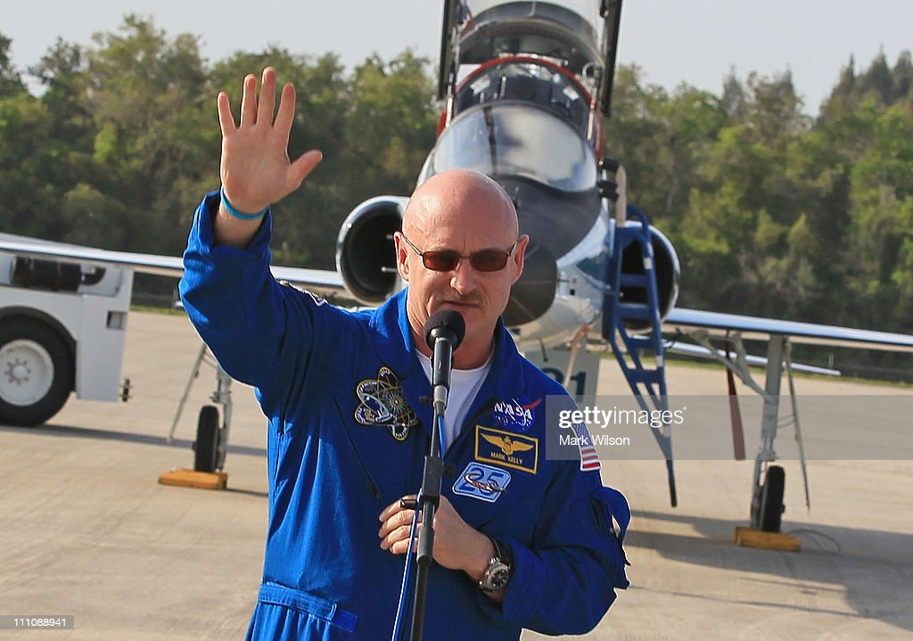 Commander <a gi-track='captionPersonalityLinkClicked' href=/galleries/search?phrase=Mark+Kelly+-+Astronaut+and+Gun+Control+Advocate&family=editorial&specificpeople=566699 ng-click='$event.stopPropagation()'>Mark Kelly</a> waves while speaking to the media after arriving at the shuttle landing facility for the Terminal Countdown Demonstration Test at Kennedy Space Spacecraft Center, on March 29, 2011 in Cape Canaveral, Florida. The TCDT will culminate in a full dress rehearsal for the planned April 19th launch of Space Shuttle Endeavour's final scheduled flight to the International Space Station before being retired.