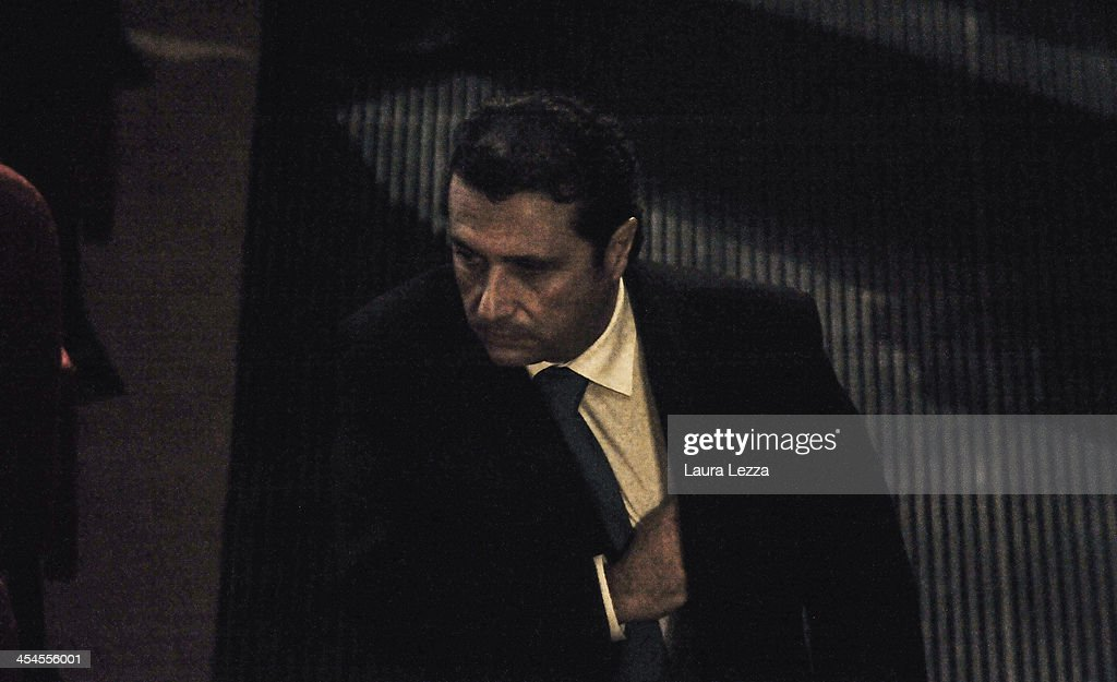 Commander of Costa Concordia Captain <a gi-track='captionPersonalityLinkClicked' href=/galleries/search?phrase=Francesco+Schettino&family=editorial&specificpeople=8797246 ng-click='$event.stopPropagation()'>Francesco Schettino</a> during the hearing in the trial of the Costa Concordia on December 9, 2013 in Grosseto, Italy. Coastguard Captain Gregorio De Falco and Captain <a gi-track='captionPersonalityLinkClicked' href=/galleries/search?phrase=Francesco+Schettino&family=editorial&specificpeople=8797246 ng-click='$event.stopPropagation()'>Francesco Schettino</a> met for the first time in court today. De Falco, famous for ordering Schettino back onboard after he allegedly abandoned the ship with hundreds of passengers still onboard, took to the stand as a witness. The Costa Concordia capsized on January 13, 2012 leaving 32 people dead.