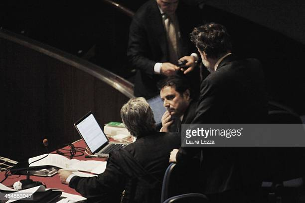 Commander of Costa Concordia Captain Francesco Schettino speaks with his lawyers during the hearing in the trial of the Costa Concordia on December 9...