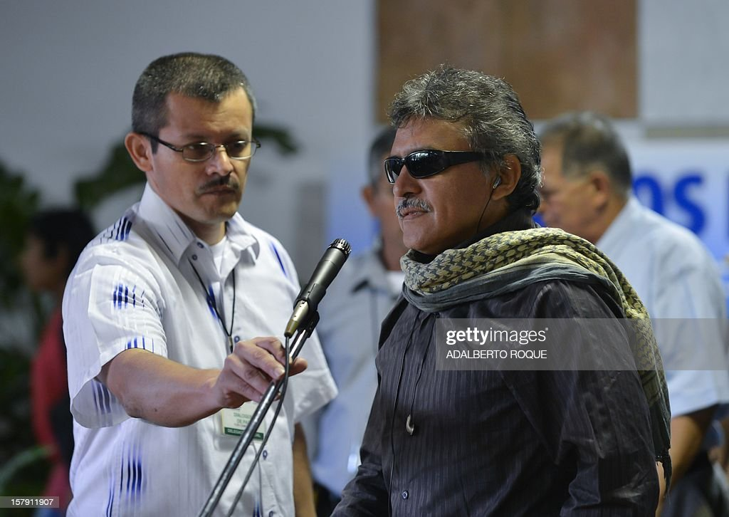 Commander of FARC-EP leftist guerrillas Jesus Santrich (R) gives a speech at Convention Palace in Havana during the peace talks with the Colombian government, on December 7, 2012.