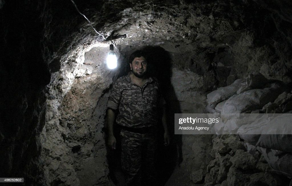 A commander of Islamic Front Abu Faisal pose in a tunnel built to hide and to take shelter from Syrian Government Forces' attacks in Aleppo, Syria on September 28, 2014.