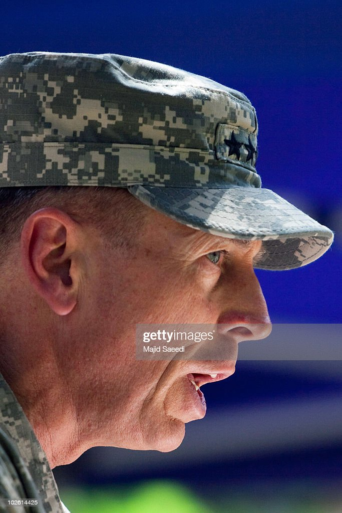Commander of NATO forces in Afghanistan US General <a gi-track='captionPersonalityLinkClicked' href=/galleries/search?phrase=David+Petraeus&family=editorial&specificpeople=175826 ng-click='$event.stopPropagation()'>David Petraeus</a> speaks during an Assumption of Command Ceremony at the International Security and Assistance Force (ISAF) Headquarters on July 4, 2010 in Kabul, Afghanistan. Appointed by US President Barack Obama (following the dismissal of US General Stanley McChrystal), US General David H Petraeus formally took up his new role of commander of the Afghan war and the 140,000 foreign troops serving in Afghanistan during a ceremony at NATO headquarters in Kabul, in which colours of US and NATO forces were handed to him by German Army General Egon Ramms, Commander of NATO's Allied Joint Forces Command Brunssum.