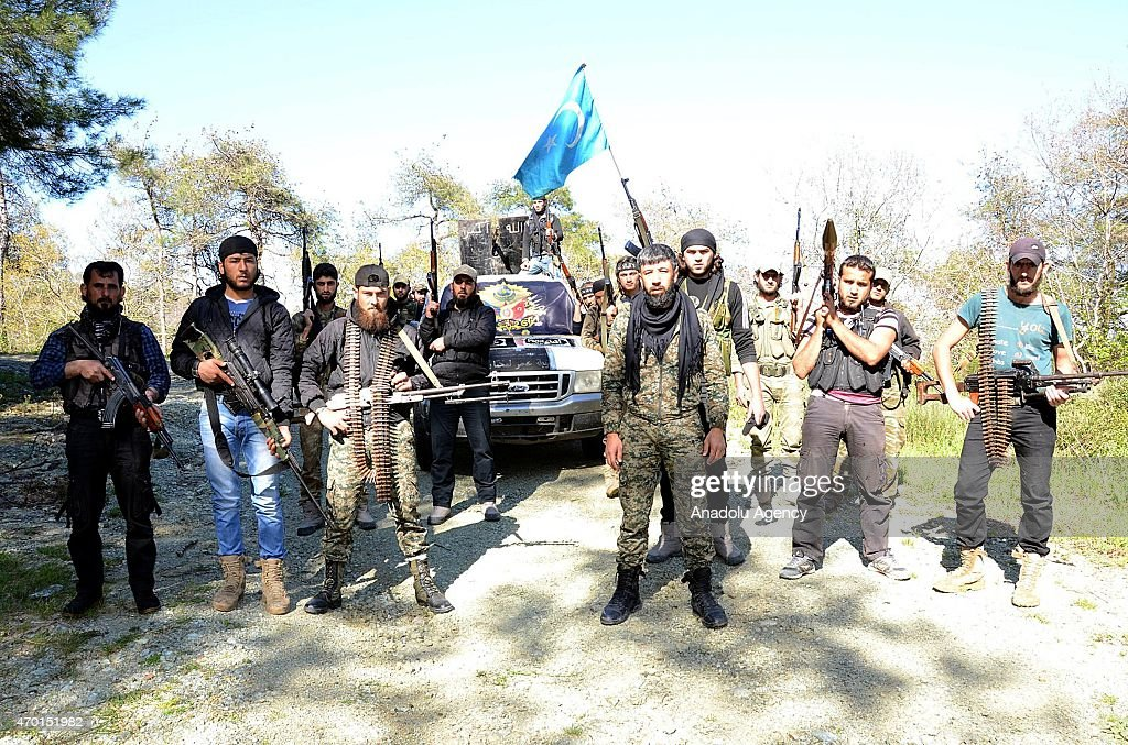 Commander of Sultan Abdul Hamid Khan brigade, Omar Abdullah (R3) speaks when Turkmen troops arrive to deploy at the mountains in fight agains Syrian Regime Forces in the Bayirbucak region in northern Latakia province of Syria on April 14, 2015.