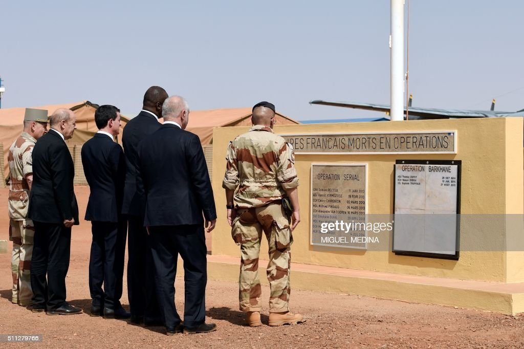 Commander of the Barkhane operation in Sahel General Patrick Brethous French Defense Minister JeanYves Le Drian and Prime Minister Manuel Valls Mali...