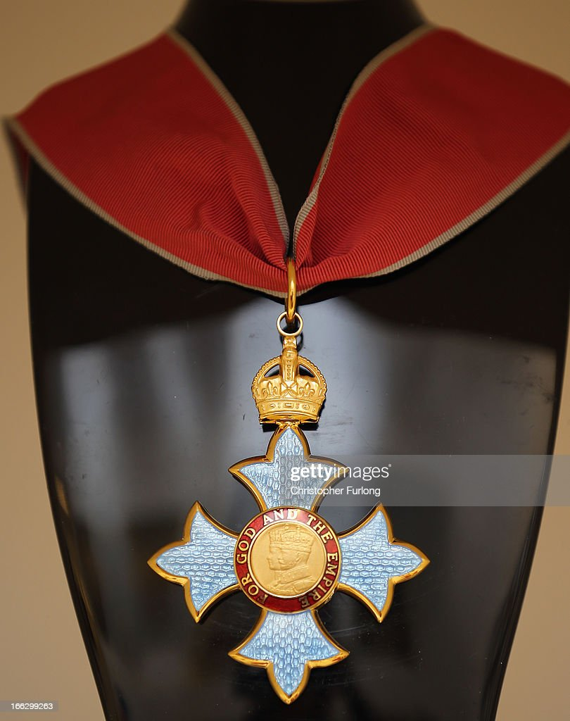 A Commander of the British Empire (CBE) medal is displayed at civil and military regalia manufacturers Toye, Kenning And Spencer on April 10, 2013 in Birmingham, England. Toye, Kenning And Spencer are the oldest fraternal regalia manufacturers in the world and were established in 1685. From their factories in Birmingham and Bedworth the company's experts in weaving, gold silversmithing, enamelling and embroidery create a vast array of regalia from civilian and military life.