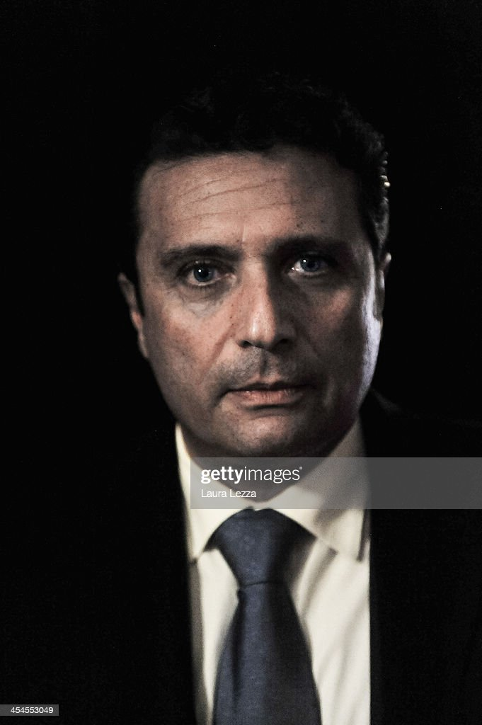 Commander of the Costa Concordia, Captain <a gi-track='captionPersonalityLinkClicked' href=/galleries/search?phrase=Francesco+Schettino&family=editorial&specificpeople=8797246 ng-click='$event.stopPropagation()'>Francesco Schettino</a> pictured during the Costa Concordia trial on December 9, 2013 in Grosseto, Italy. Coastguard Captain Gregorio De Falco and Captain <a gi-track='captionPersonalityLinkClicked' href=/galleries/search?phrase=Francesco+Schettino&family=editorial&specificpeople=8797246 ng-click='$event.stopPropagation()'>Francesco Schettino</a> met for the first time in court today. De Falco, famous for ordering Schettino back onboard after he allegedly abandoned the ship with hundreds of passengers still onboard, took to the stand as a witness. The Costa Concordia capsized on January 13, 2012 leaving 32 people dead.