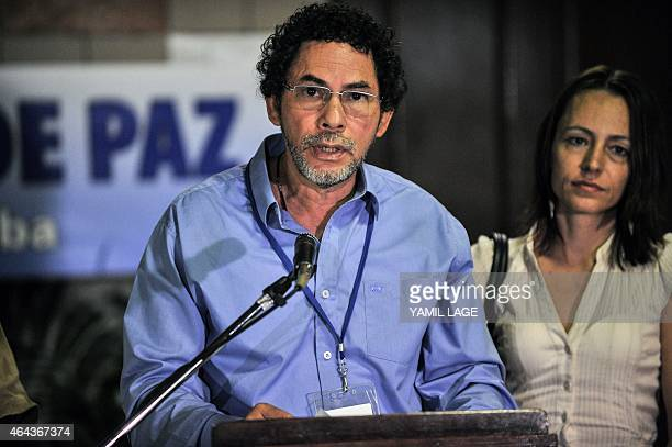 Commander of the FARC EP leftist guerrillas Pastor Alape reads a statement at Convention Palace in Havana as they arrive for the peace talks with the...